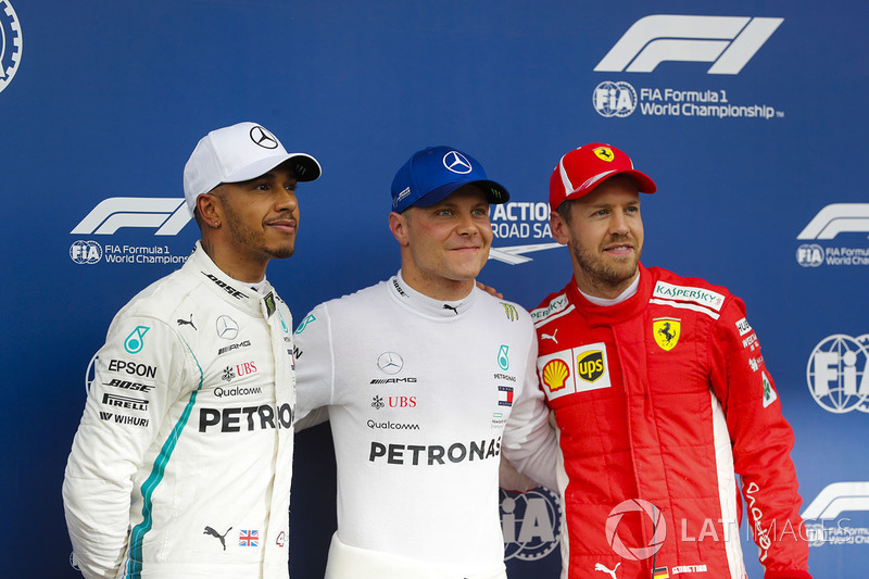 Pole sitter Valtteri Bottas, Mercedes AMG F1, poses with second place Lewis Hamilton, Mercedes AMG F1, and third place Sebastian Vettel, Ferrari