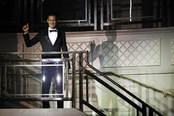Sébastien Ogier walks down the stairs to the Great Room