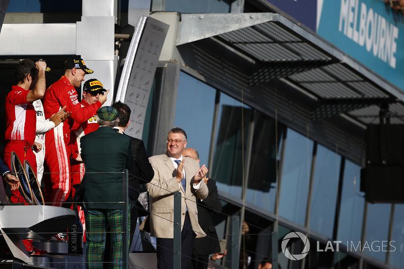 Lewis Hamilton, Mercedes AMG F1, 2nd position, Sebastian Vettel, Ferrari, 1st position, and Kimi Raikkonen, Ferrari, 3rd position, celebrate on the podium