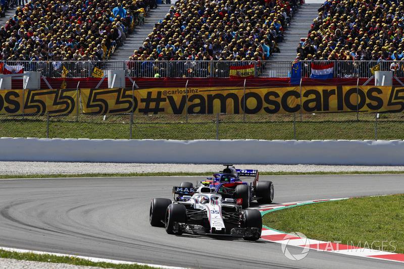 Сергей Сироткин, Williams FW41, и Брендон Хартли, Scuderia Toro Rosso STR13