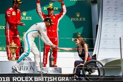 Lewis Hamilton, Mercedes AMG F1, 2nd position, shakes hands with Nathalie McGoin on the podium