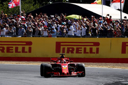 Race winner Sebastian Vettel, Ferrari SF71H, waves to the crowd