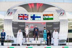 Podium: race winner Niko Kari, Arden International, second place George Russell, ART Grand Prix, thi