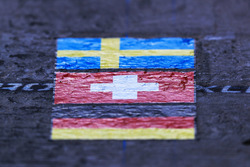 Swedish flag, Swiss flag and German flag in Sauber pit box