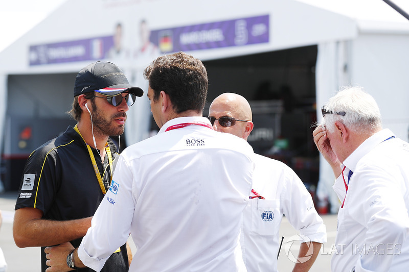 Jean-Eric Vergne, Techeetah, talks with FIA personnel in the pits