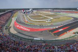 Fernando Alonso, McLaren MCL33, leads Sergio Perez, Force India VJM11, and Lewis Hamilton, Mercedes AMG F1 W09