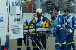 Fernando Alonso, Renault Renault F1 Team R23, gets put into an ambulance on a strecher