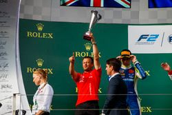 PREMA Racing team member collects the trophy