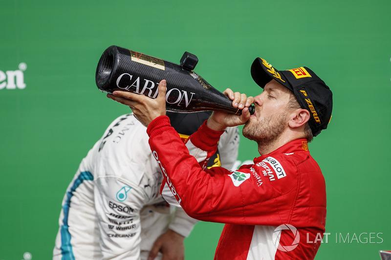 Sebastian Vettel, Ferrari, 1st position, drinks Champagne on the podium