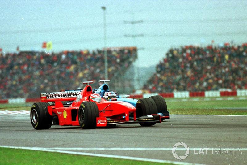 Eddie Irvine, Ferrari, Alexander Wurz, Benetton