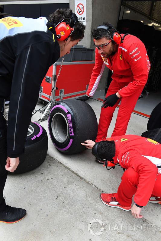Ferrari and Pirelli engineers with Pirelli tyres