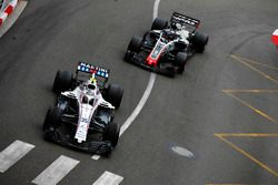 Sergey Sirotkin, Williams FW41, leads Romain Grosjean, Haas F1 Team VF-18