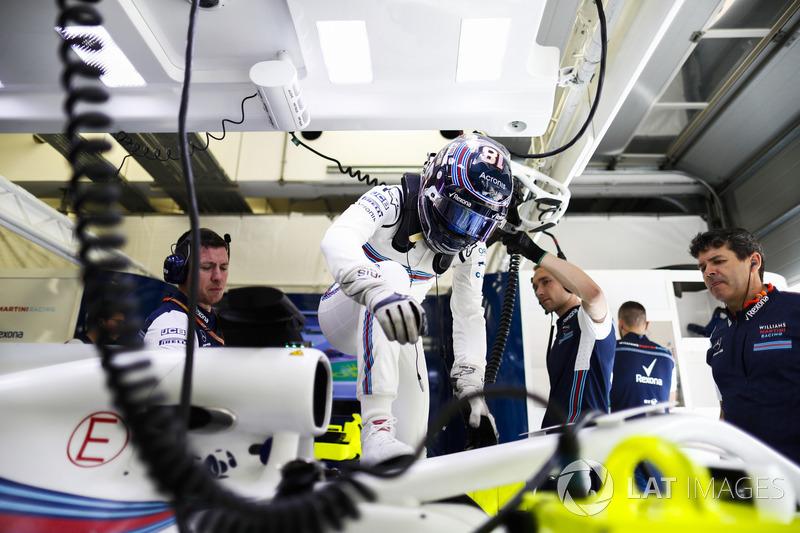 Lance Stroll, Williams Racing, climbs into his car