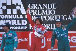 Podium: race winner Alain Prost, second place Ivan Capelli, third place Thierry Boutsen
