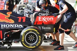 Sergio Perez, Red Bull Racing RB16B, in the pits during practice