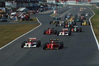 Start action, Alain Prost, Ferrari 641 leads Ayrton Senna, McLaren MP4/5B Honda