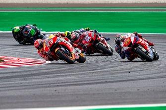 Marc Marquez, Repsol Honda Team overtakes Jack Miller, Pramac Racing, Andrea Dovizioso, Ducati Team