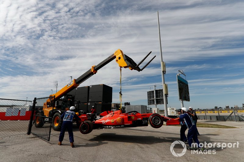 Marshals remove the car of Charles Leclerc, Ferrari SF90