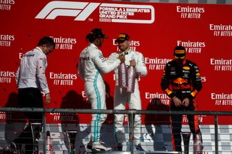 James Allison, Technical Director, Mercedes AMG, Lewis Hamilton, Mercedes AMG F1, 2nd position, Valtteri Bottas, Mercedes AMG F1, 1st position, and Max Verstappen, Red Bull Racing, 3rd position, celebrate with Champagne on the podium