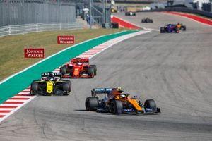 Lando Norris, McLaren MCL34, leads Daniel Ricciardo, Renault R.S.19, and Sebastian Vettel, Ferrari SF90