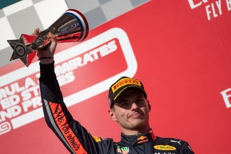 Max Verstappen, Red Bull Racing, 3rd position, lifts his trophy on the podium