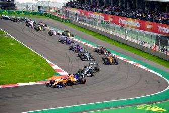 Carlos Sainz Jr., McLaren MCL34 leads Lewis Hamilton, Mercedes AMG F1 W10, Lando Norris, McLaren MCL34 and Valtteri Bottas, Mercedes AMG W10