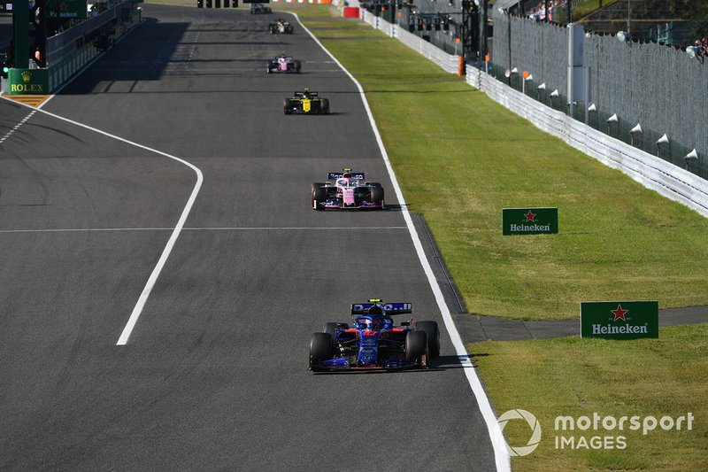 Pierre Gasly, Toro Rosso STR14, leads Lance Stroll, Racing Point RP19, and Nico Hulkenberg, Renault F1 Team R.S. 19