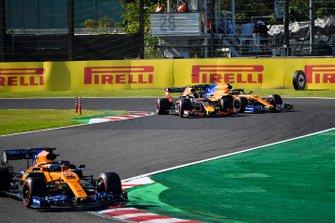 Carlos Sainz Jr., McLaren MCL34, leads Alex Albon, Red Bull RB15, and Lando Norris, McLaren MCL34