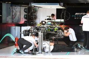 Mechanics working on the Mercedes AMG F1 W10
