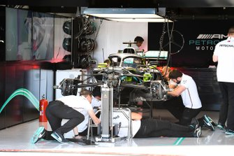 Mechanics working on the Mercedes AMG F1 W10