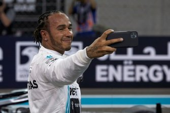 Lewis Hamilton, Mercedes AMG F1, takes a selfie on the grid after securing pole