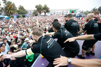 The Panasonic Jaguar Racing team celebrate on the podium
