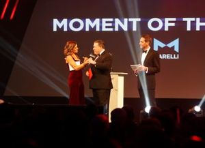 Zak Brown, Executive Director, McLaren, presents the Moment of the Year award