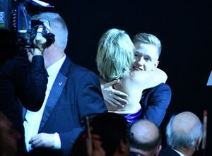 Johnathan Hoggard celebrates with family and friends after winning the Aston Martin Autosport BRDC Young Driver Award