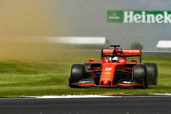 Sebastian Vettel, Ferrari SF90, goes over the grass