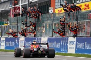 Alex Albon, Red Bull RB15, is congratulated at the finish by his team