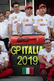 Mattia Binotto, Team Principal Ferrari, Charles Leclerc, Ferrari, and Sebastian Vettel, Ferrari, join the Ferrari team in celebrating their 90th anniversary