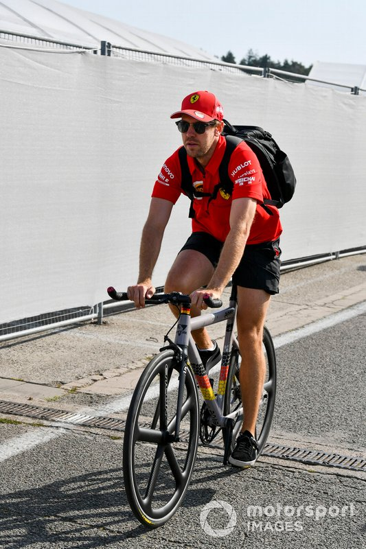Sebastian Vettel, Ferrari arrives on a bike