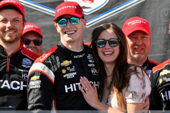 Josef Newgarden, Team Penske Chevrolet Ashley Welch celebrate the championship on the podium
