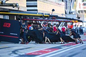 Red Bull mechanics wheel back the Alex Albon Red Bull RB15 in qualifying