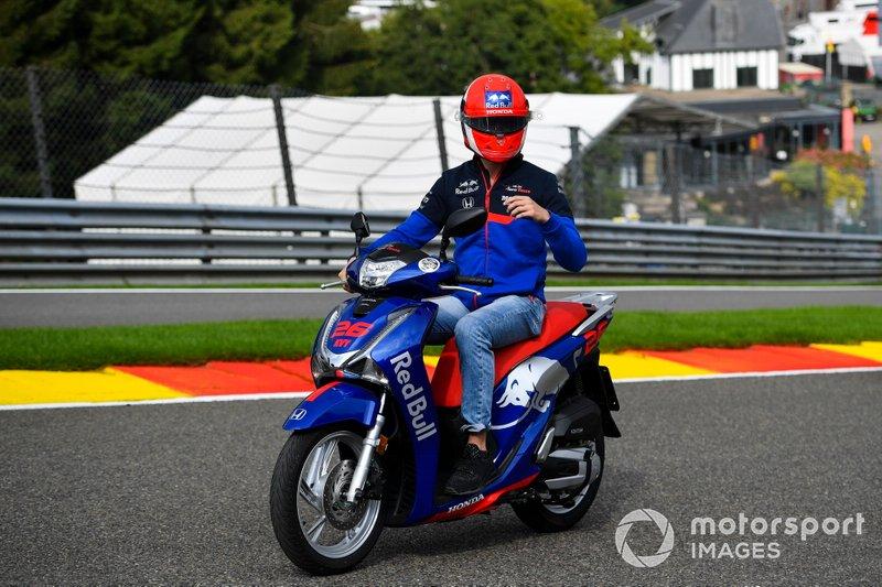 Daniil Kvyat, Toro Rosso, rides a scooter