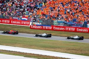 Max Verstappen, Red Bull Racing RB15, leads Valtteri Bottas, Mercedes AMG W10, and Lewis Hamilton, Mercedes AMG F1 W10