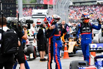 Max Verstappen, Red Bull Racing, 1st position, and Daniil Kvyat, Toro Rosso, 3rd position, congratulate each other after the race