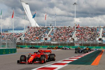 Charles Leclerc, Ferrari SF90, leads Lewis Hamilton, Mercedes AMG F1 W10, Carlos Sainz Jr., McLaren MCL34, Valtteri Bottas, Mercedes AMG W10, Lando Norris, McLaren MCL34, and the remainder of the field at the start