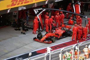 Sebastian Vettel, Ferrari SF90, leaves his pit box after a stop