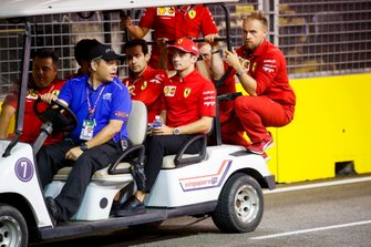 Charles Leclerc, Ferrari walks the track on a gold buggy