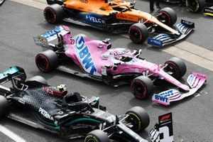 The cars of Pole sitter Valtteri Bottas, Mercedes F1 W11, Nico Hulkenberg, Racing Point RP20, Lando Norris, McLaren MCL35, and Daniel Ricciardo, Renault F1 Team R.S.20, in Parc Ferme after Qualifying