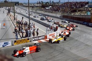 Andrea de Cesaris, Alfa Romeo 182, leads René Arnoux, Renault RE30B, Niki Lauda, McLaren MP4-1B Ford, Bruno Giacomelli, Alfa Romeo 182, and Gilles Villeneuve, Ferrari 126C2, at the start