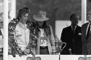 Race winner Jochen Rindt on the podium with wife, Nina