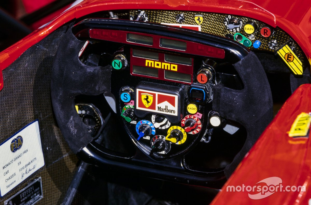 The steering wheel in one of the Ferrari F310Bs